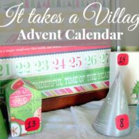 A cover image for a blog post about making a random acts of kindness advent calendar. The image shows the homemade advent calendar village and the text says