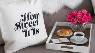 decorative throw pillow with words on sofa
