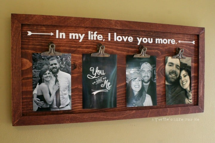 A Homemade Wood Photo Display Board withh personal photographs clipped on