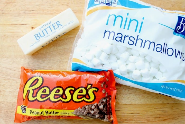 a bag of mini marshmallows, bag of peanut butter chips and a stick of butter