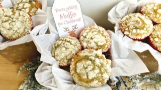 2 muffin gift baskets packaged with tissue paper and a tag that says,