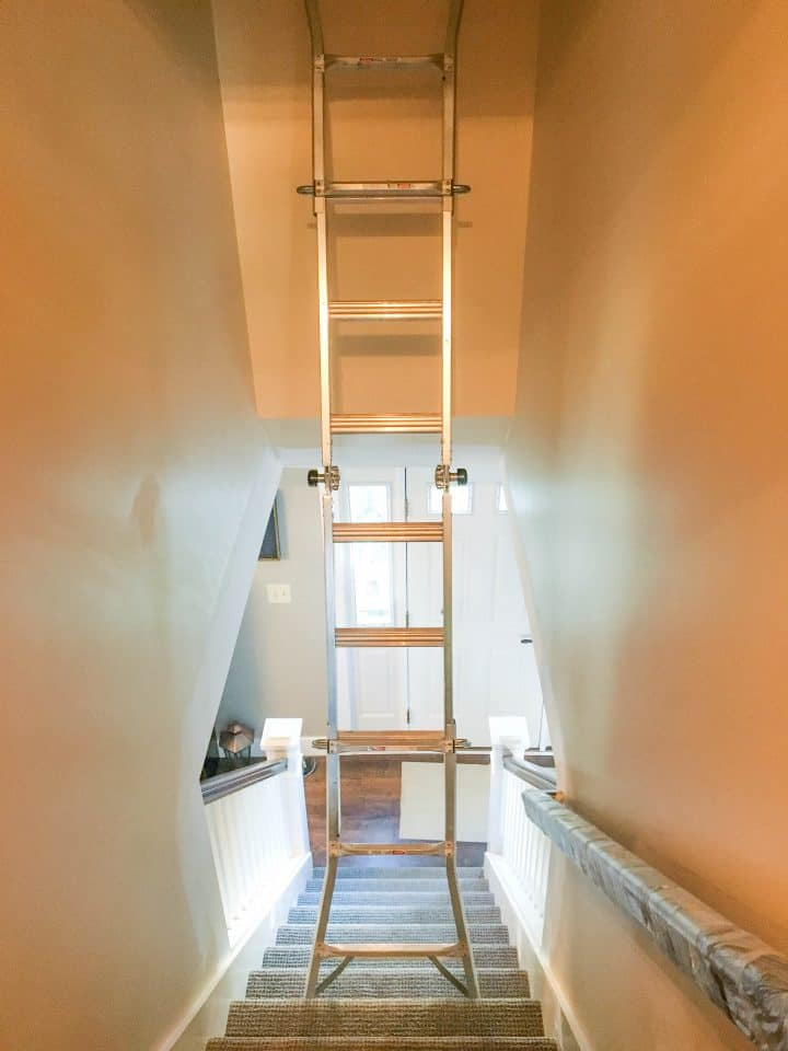 Step 2 using a ladder to paint a stairwell