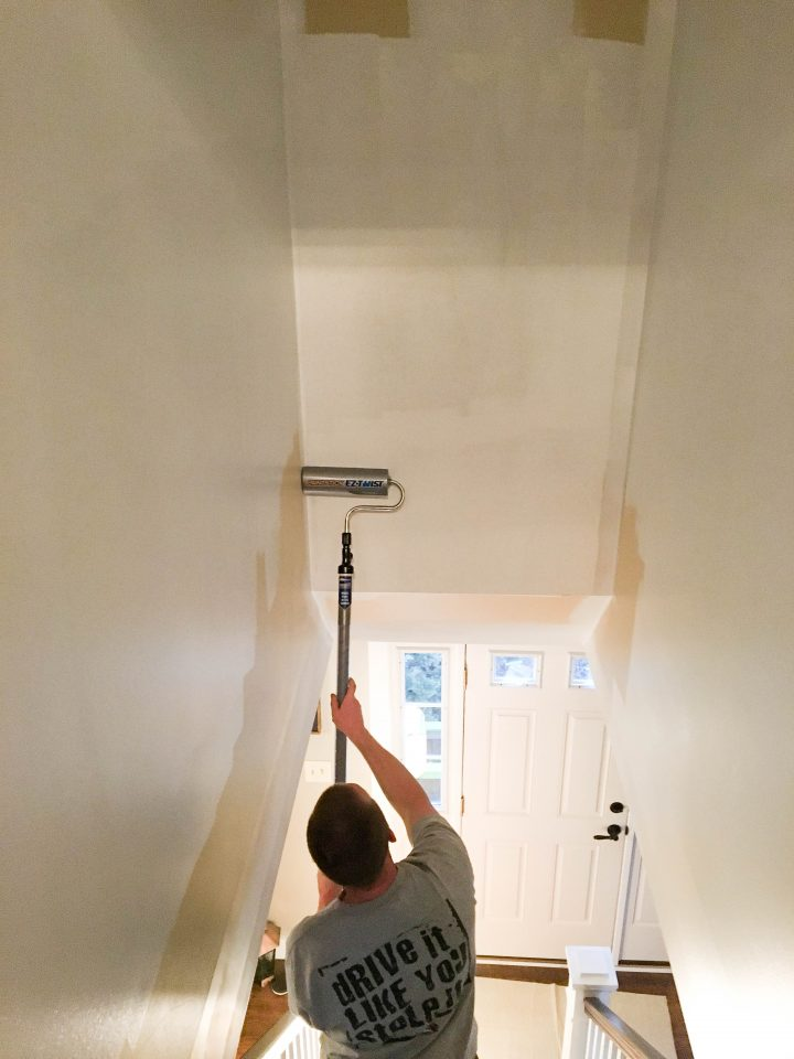 Step 5 painting a stairwell with a paintstick