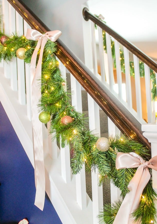 how to make faux evergreen stair garlands with LED lights