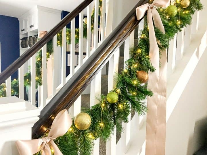 how to make faux evergreen staircase garland with LED Christmas lights with ribbons