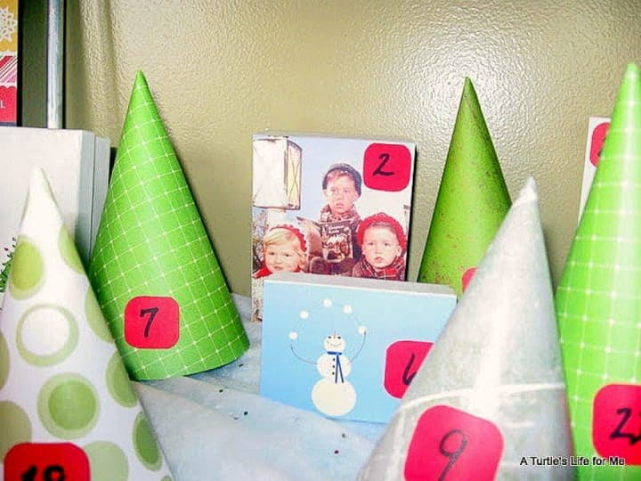 A random acts of kindness homemade advent calendar made of cardboard and scapbook paper