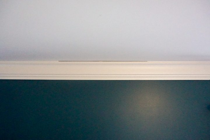 crown molding against a teal wall