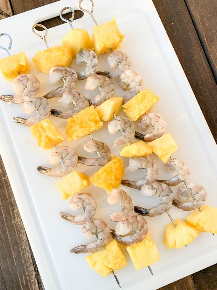 how to make shrimp kebabs. A process photo showing pineapple and shrimp on a skewer