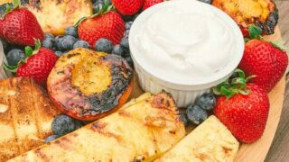 grilled pineapple and peaches with strawberries, blueberries and grilled pound cake