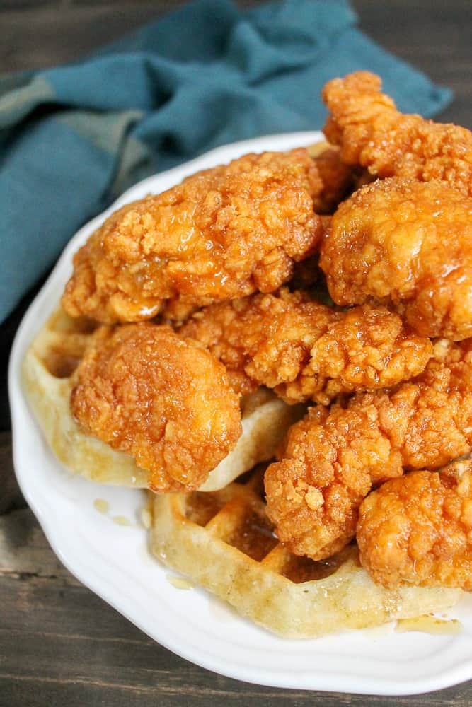 crispy chicken and waffles with honey and maple syrup drizzle