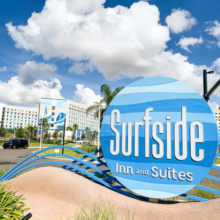 Surfside Inn and Suites sign with the building in the background