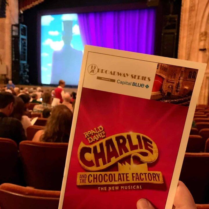 Charlie and the Chocolate Factory playbill with the stage behind it
