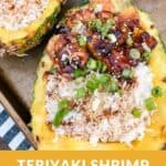 A pinterest pin with an image of a terriyaki shrimp rice bowl served in a pineapple boat on a baking sheet. The text says, Teriyaki Shrimp Pineapple Boats