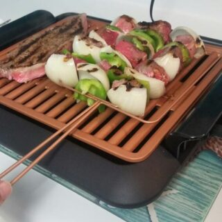 Veggie and Meat Skewers being grilled on an indoor grill