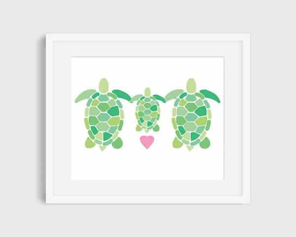An art print of  a family of 2 adult and one baby turtles painted in graphic blocks with a pink heart
