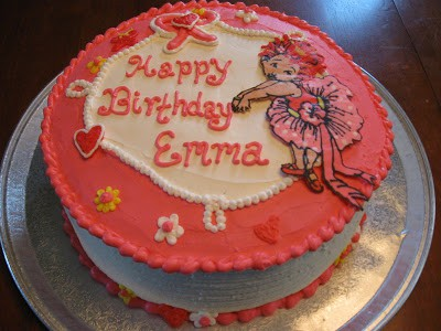 A photograph of a homemade Fancy Nancy Birthday Cake made using edible icing sheet transfers