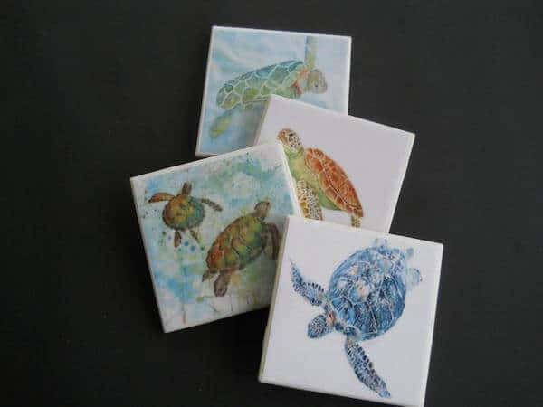 4 ceramic tile coasters with  watercolor turtles painted on each