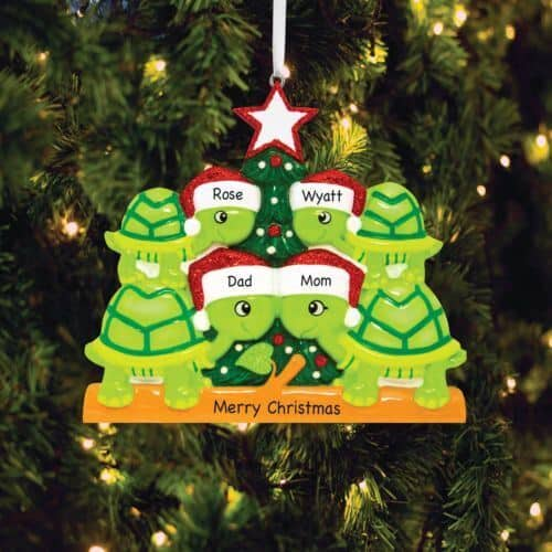 A christmas ornament featuring 4  ceramic turtles that make up a turtle family wearing Santa hats.