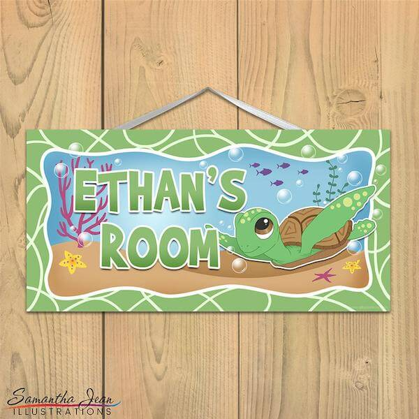 A personalized name plaque for kids featuring a cartoon sea turtle  under the sea.