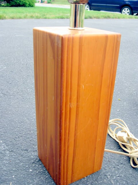 A before photo for a thrift store lamp makeover to make a michael jackson lamp. The photo is of an old rectangular wood lamp base