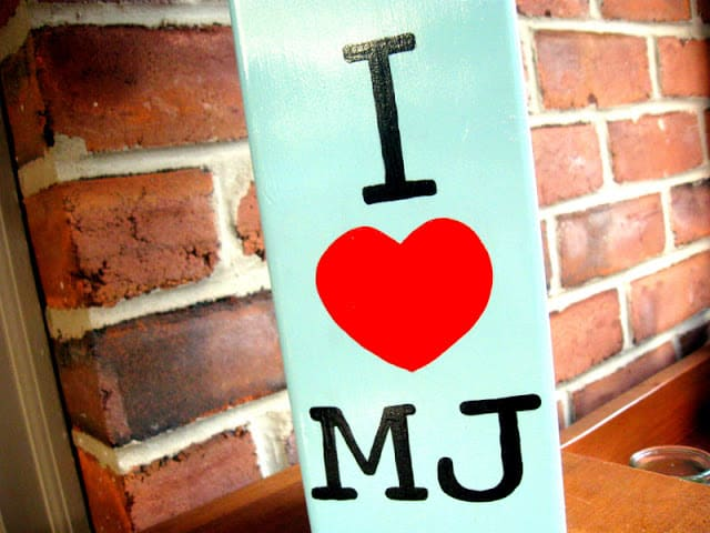 A DIY Michael Jackson Lamp that says I Heart MJ on a painted thrift store lamp