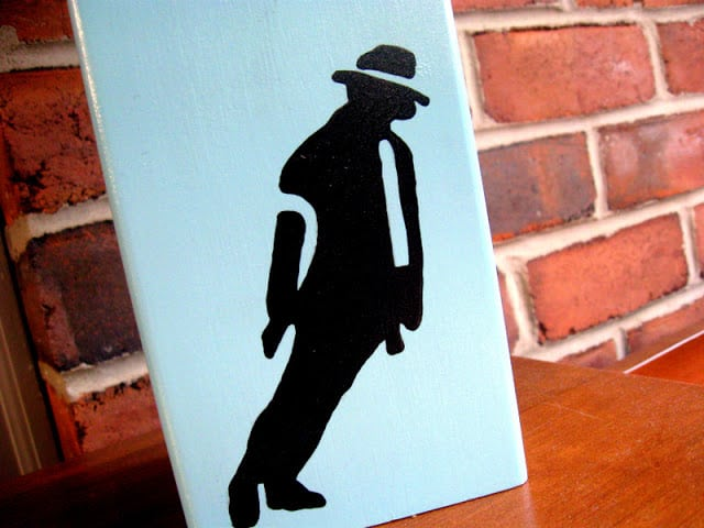 A michael jackson silhouette on a painted thrift store lamp base
