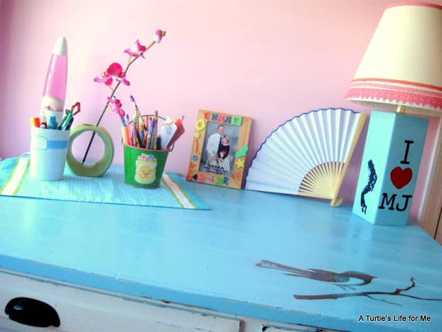 A completed desk makeover project with a blue desktop.