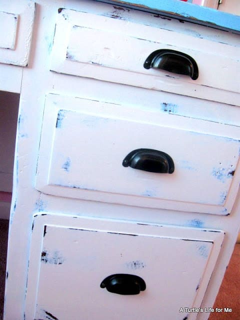 A final photo of a DIY desk project shows distressed desk drawers in white and blue
