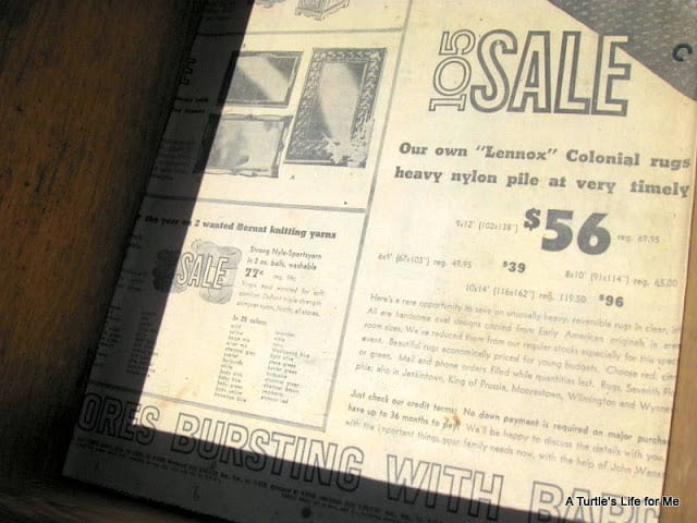 Old newspapers from the 1960s line the drawers of an old wooden desk before a makeover.