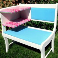 An after photo showing an upcycled bench for a girls room. The bench is white, blue, and pink