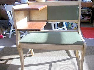 An old and tired telephone bench in need of TLC sits in a garage before a bench upcycle project