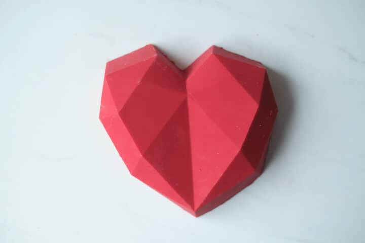 An edible chocolate heart box made from red candy melts. Fill with wrapped candies or chocolates for a Valentine's day gift.