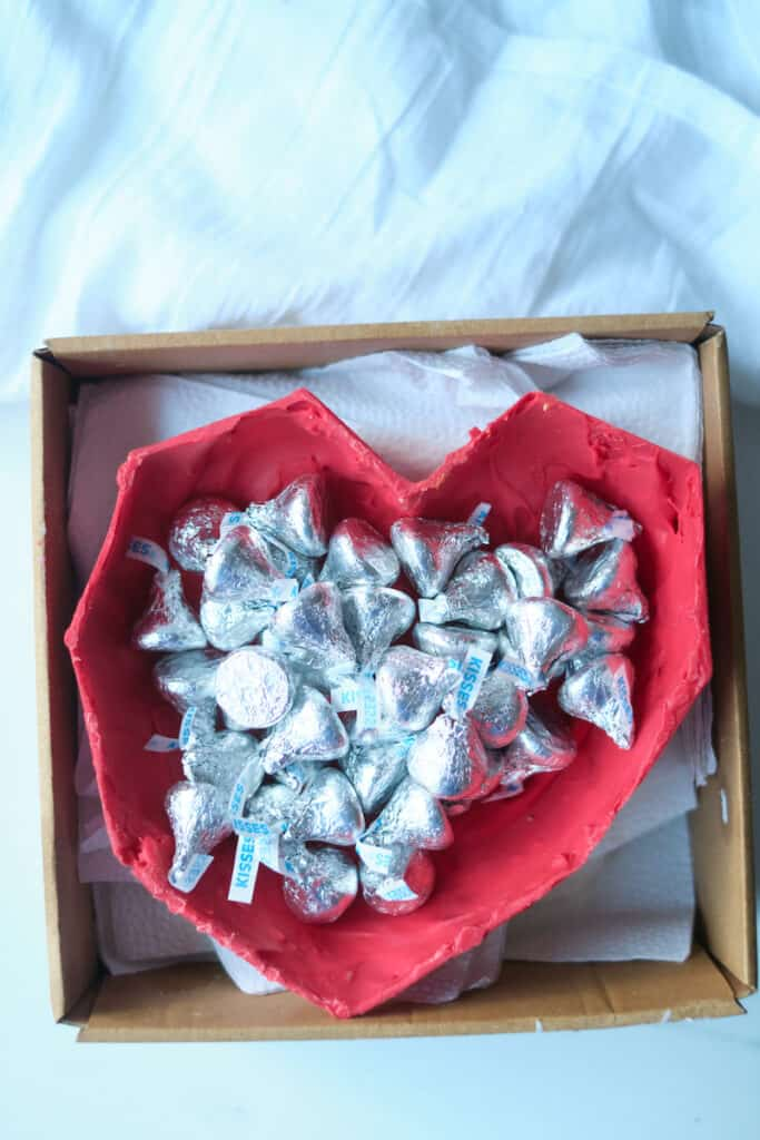 An edible chocolate heart box filled with wrapped Hershey's chocolate kisses.