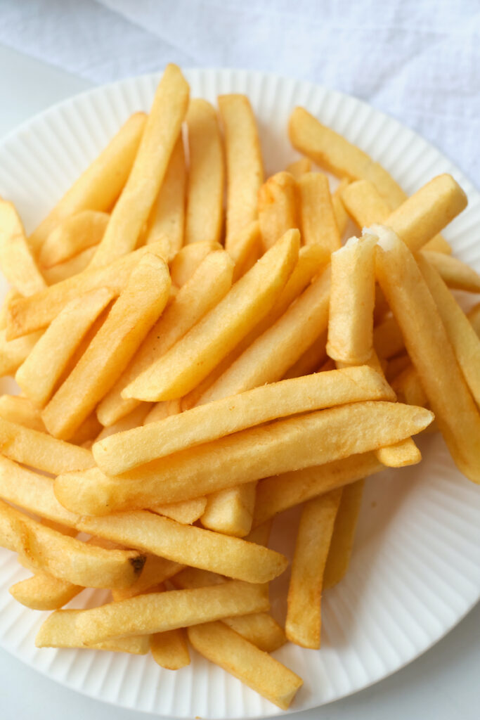 A plate of cooked french fries
