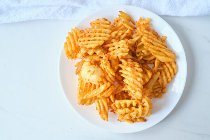 A plate of perfectly cooked waffle fries