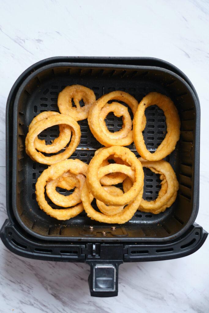 Frozen onion rings in air fryer basket