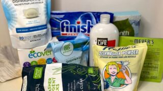 10 different brands of dishwasher detergent stand on a white counter prior to testing them to find the best