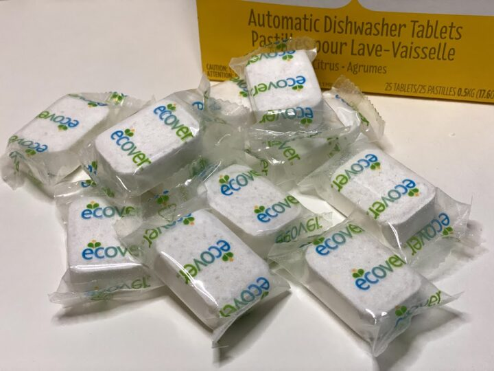 Individually wrapped Ecover dishwasher tablets scattered on a table